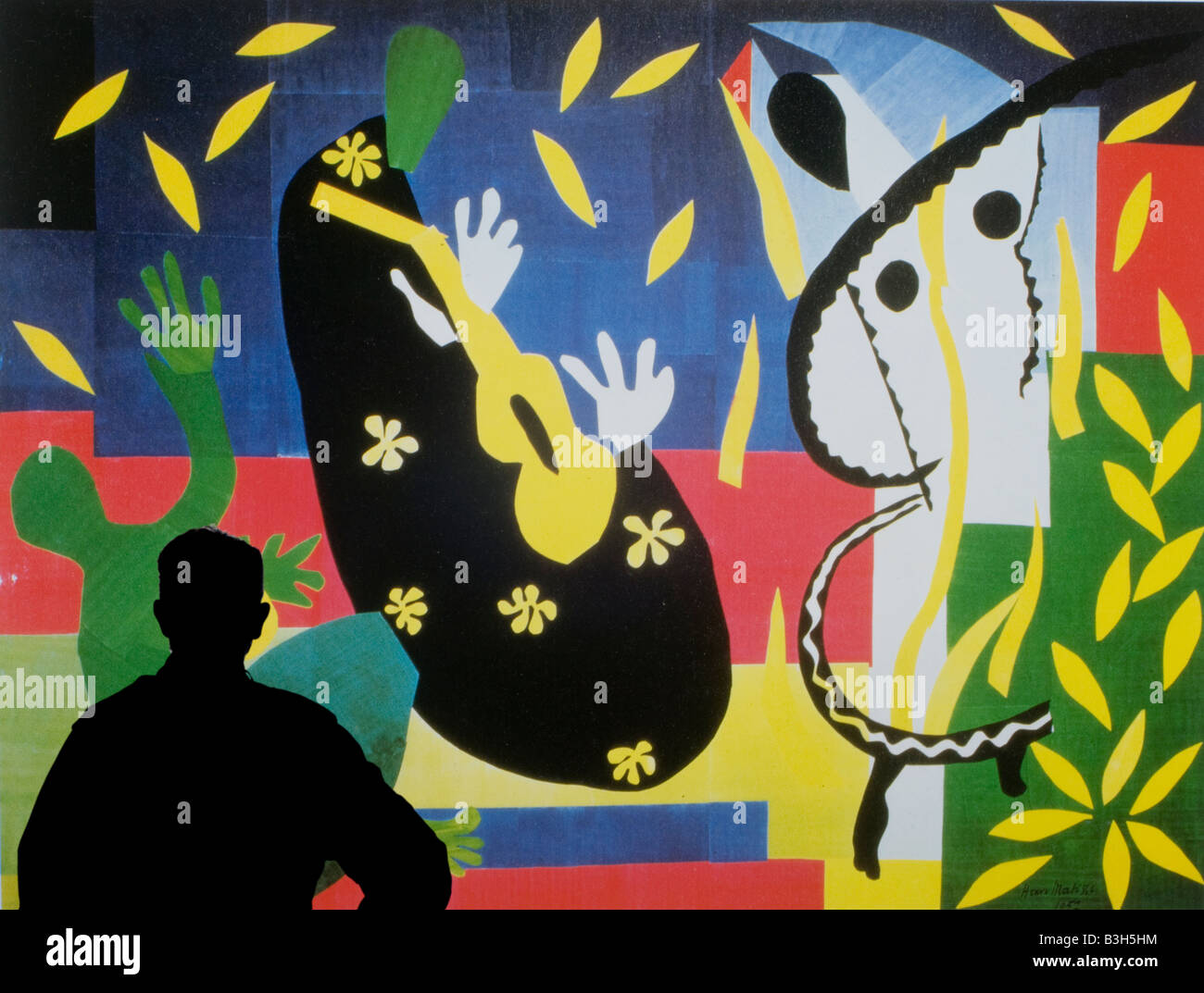 man studying poster of Sorrow of the King 1952 by Henri Matisse (1869 - 1954) - Stock Image