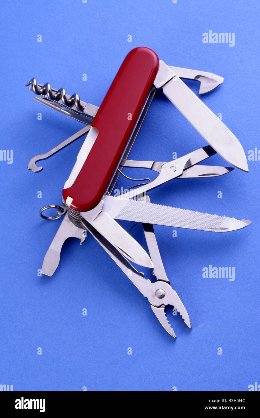 All-purpose Swiss army knife fully opened on white background - Stock Image