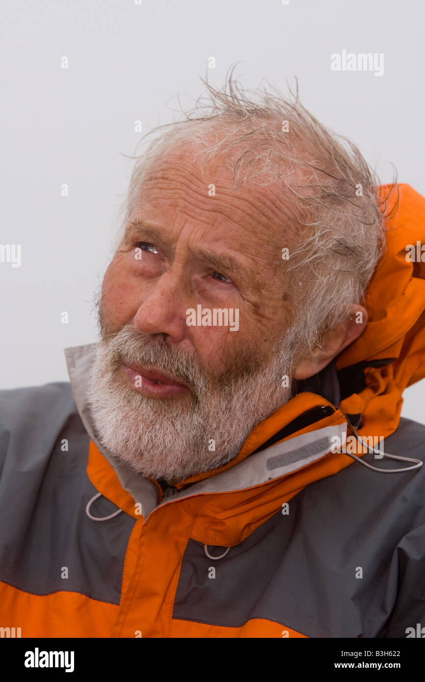 Sir Chris Bonington, pictured on the summit of Scafell Pike in the English Lake District - Stock Image