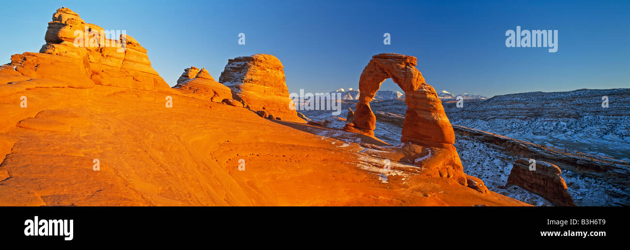 USA, Utah, Arches National Park, Delicate Arch and La Sal mountains - Stock Image