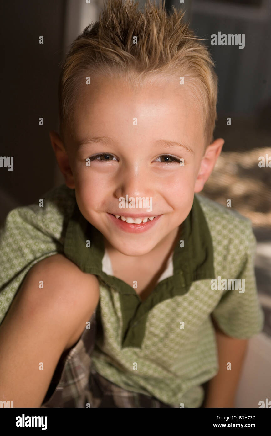 portrait of smiling four year old boy, closeup, toothy grin - Stock Image