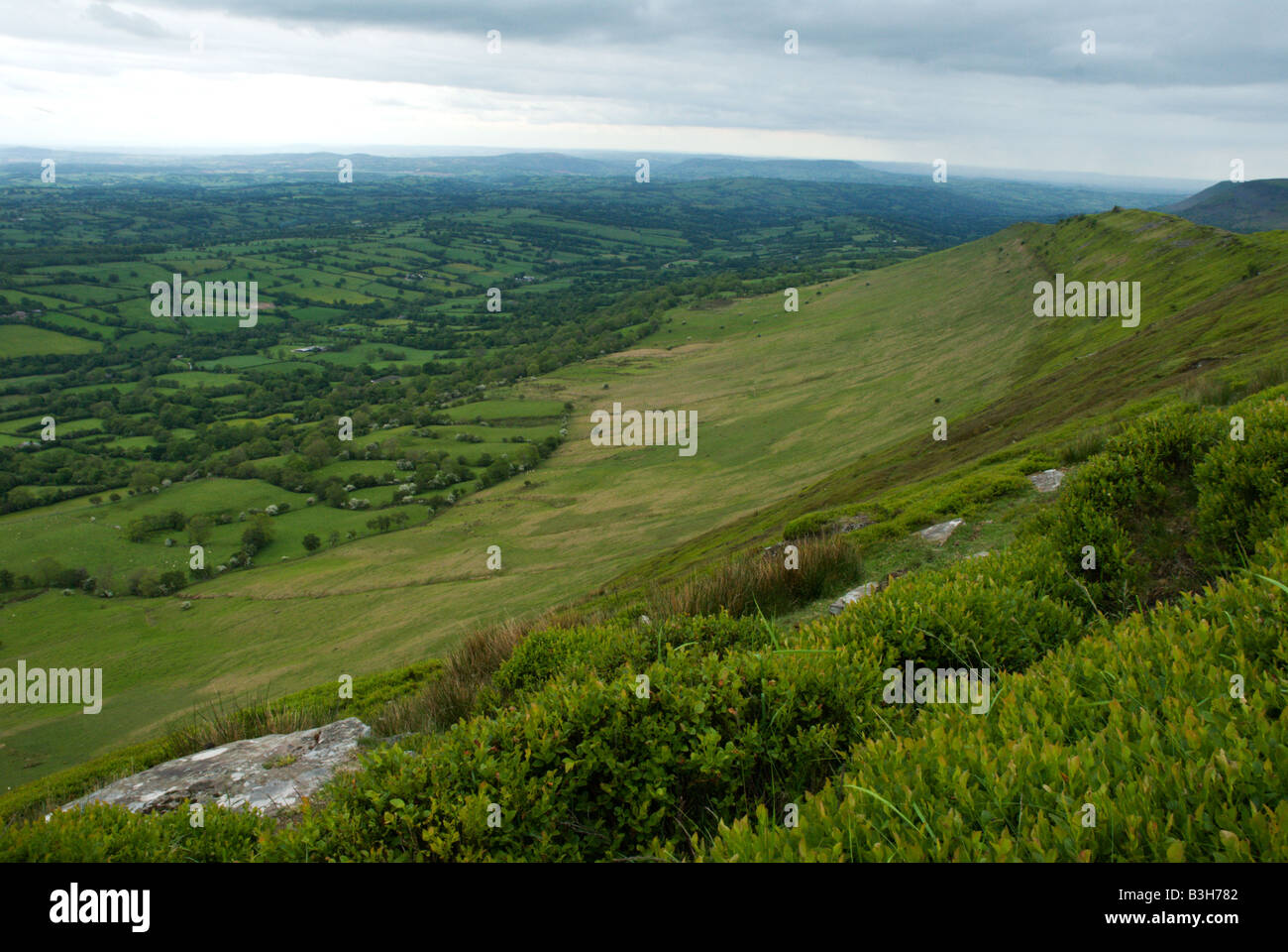 A long sweeping view of the high moor above the tiny fields in the Welsh Border Country along Offa's Dyke near - Stock Image