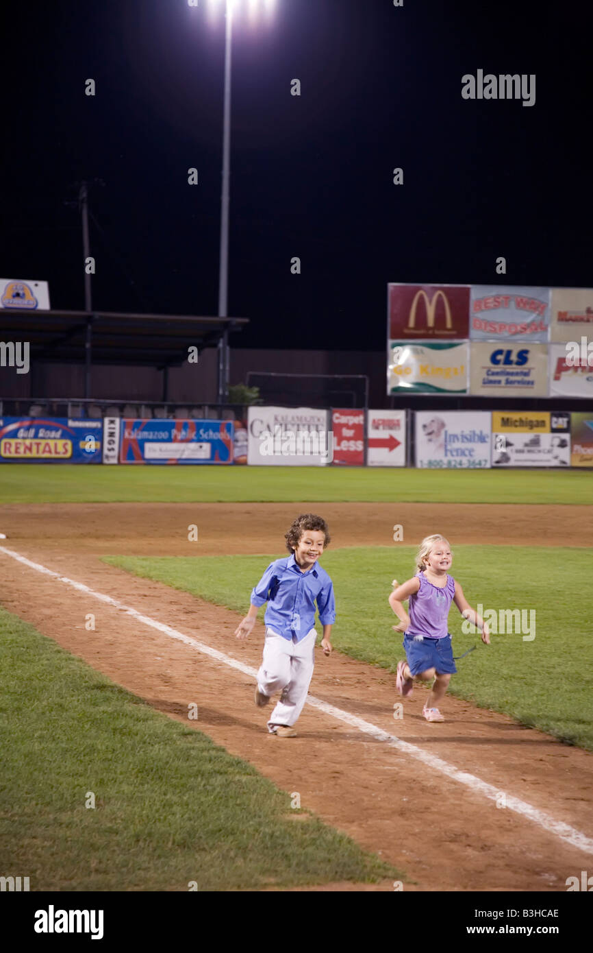 Children Run the Bases after Baseball Game - Stock Image