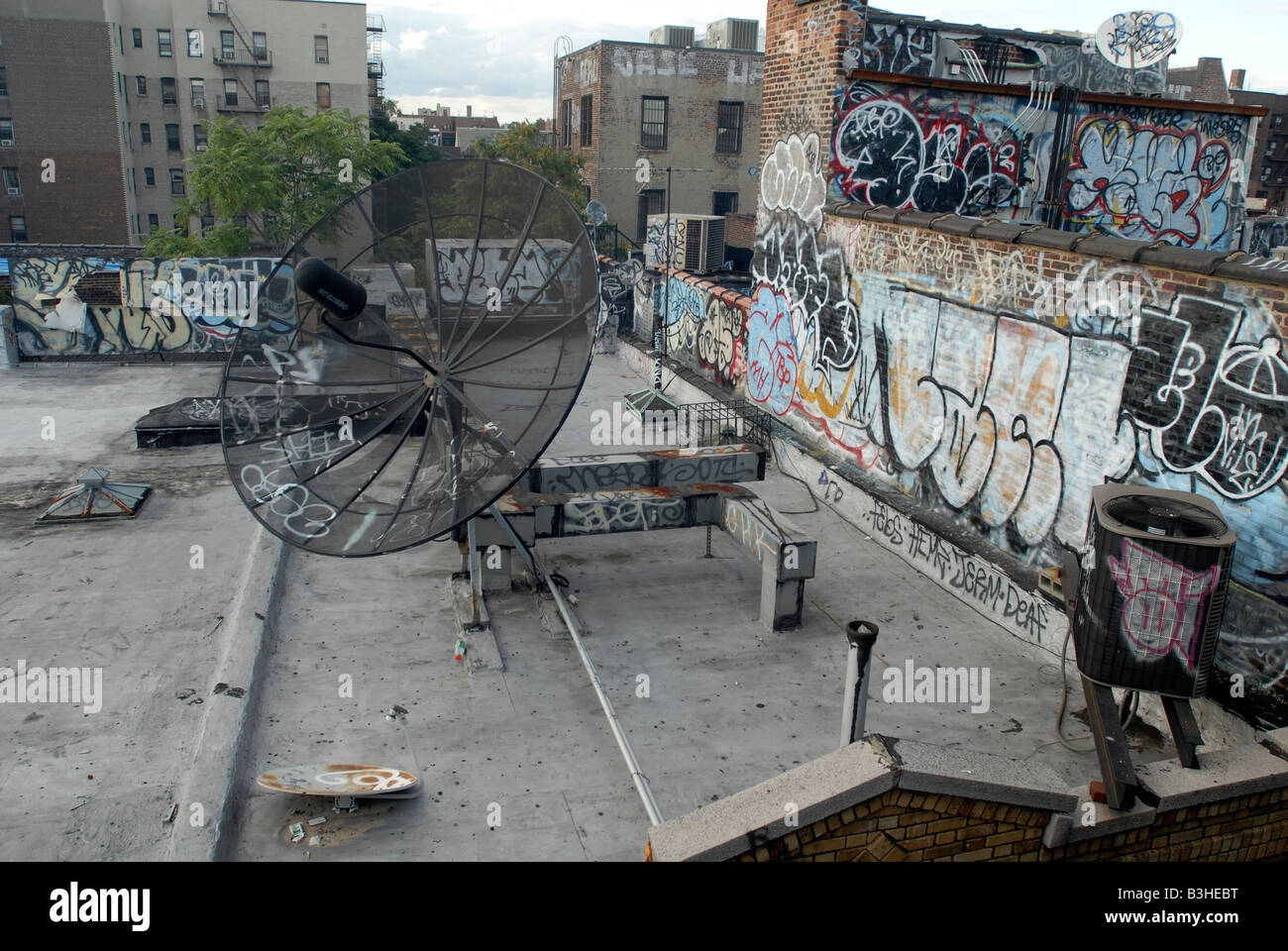Graffiti and other vandalism on a rooftop in the Jackson Heights neighborhood of New York in the borough of Queens - Stock Image