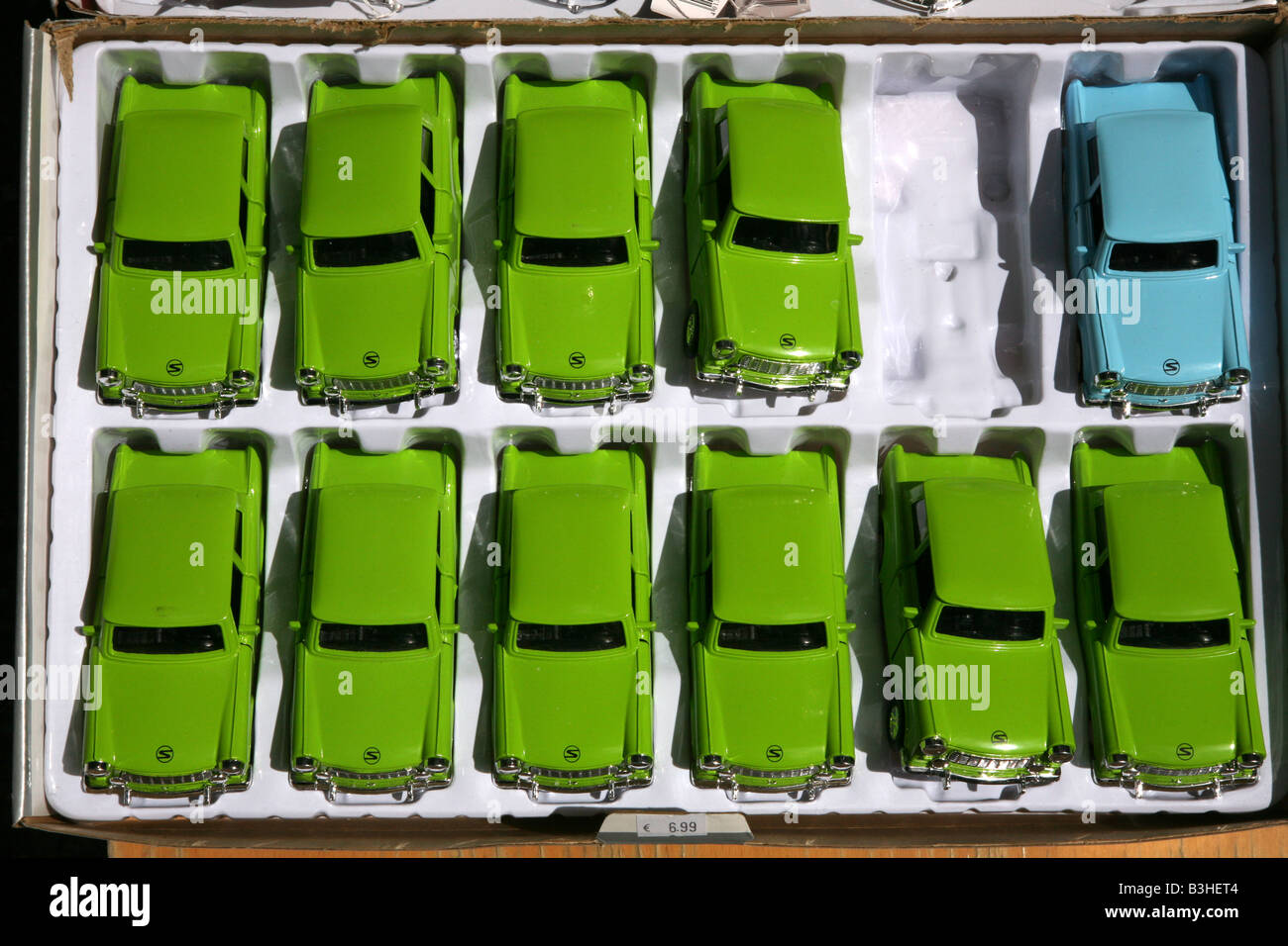 Trabant toy cars in the street market near the Check point Charlie in Berlin, Germany - Stock Image