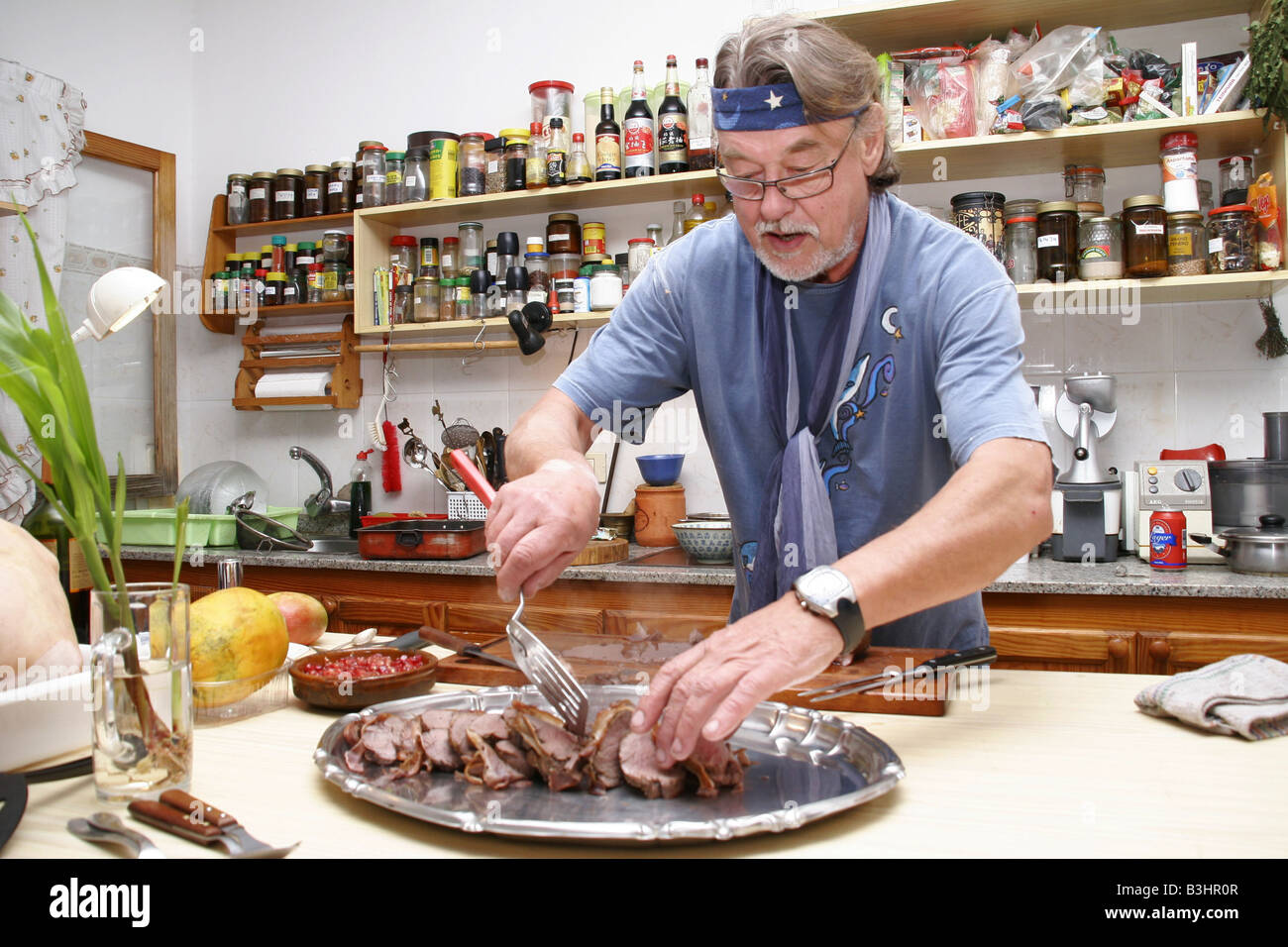 man in the kitchen - Stock Image