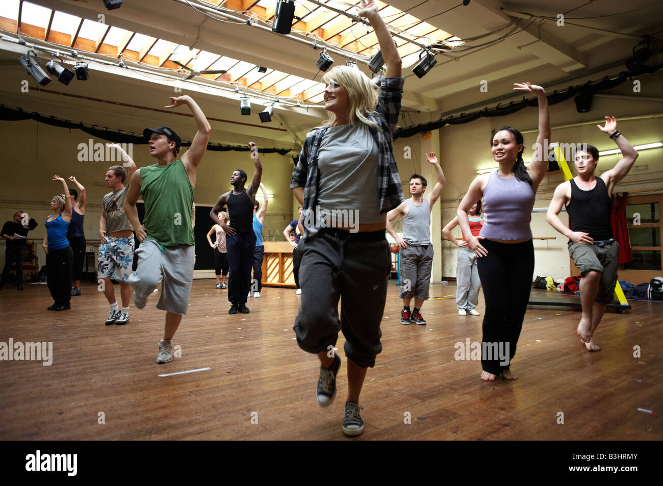 Cast members of High School Musical rehearse their song and dance routines at the Dance Attic, Fulham, London - Stock Image