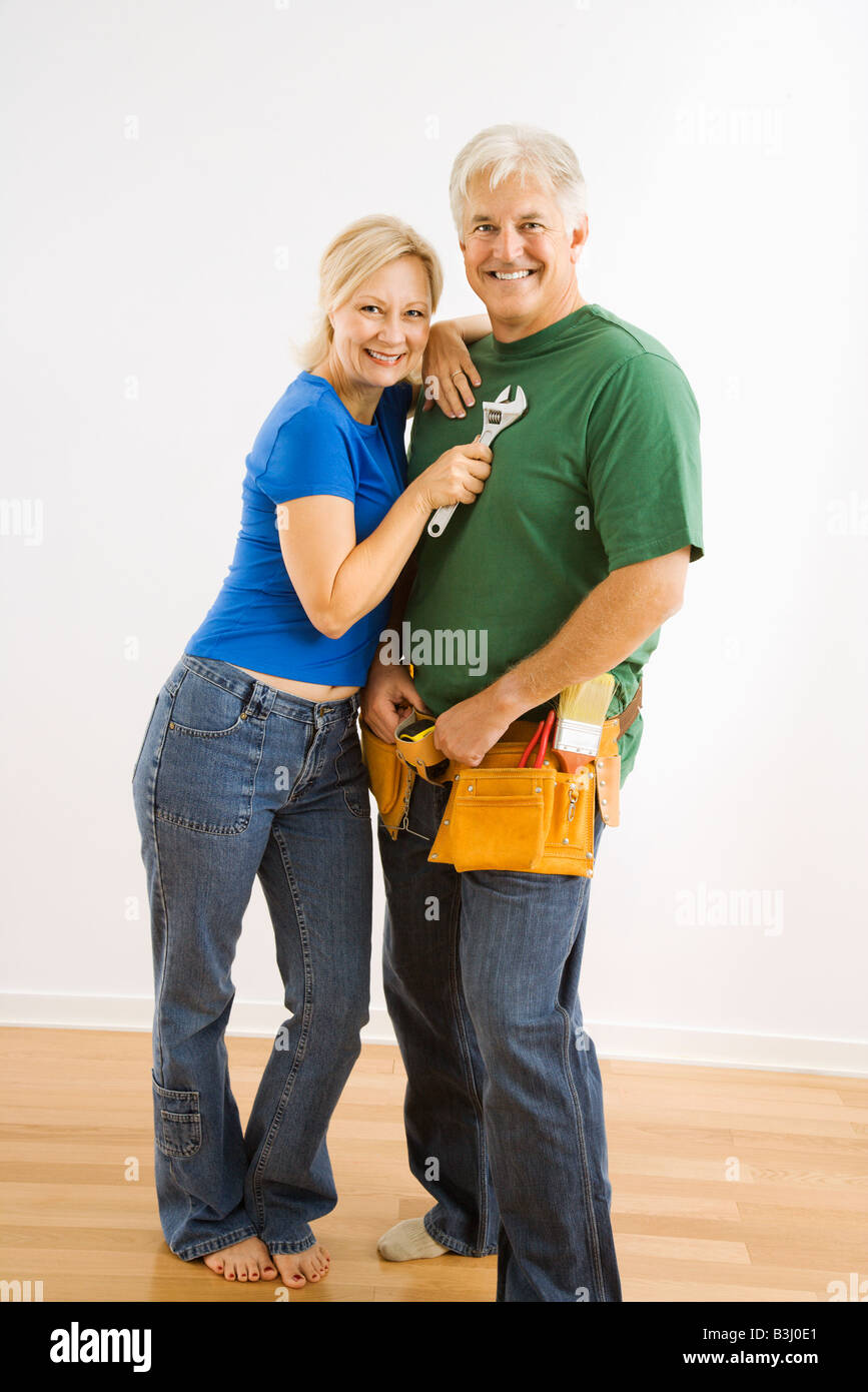 Middle aged couple with household tools - Stock Image