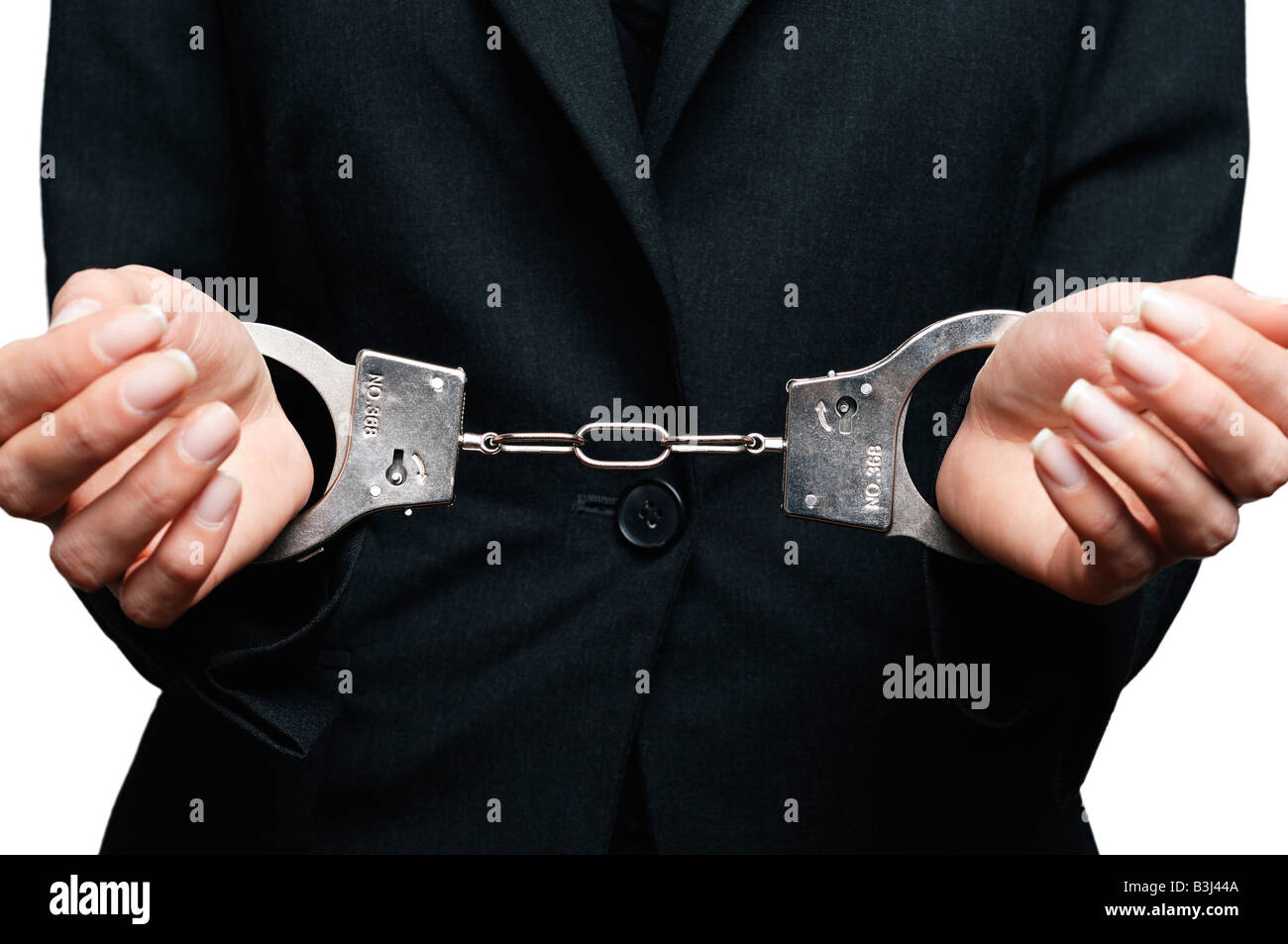 Businesswoman in Handcuffs Close Up Stock Photo