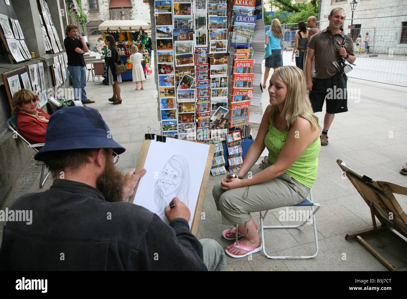 Street artist drawing a caricature,  Cracow Poland - Stock Image