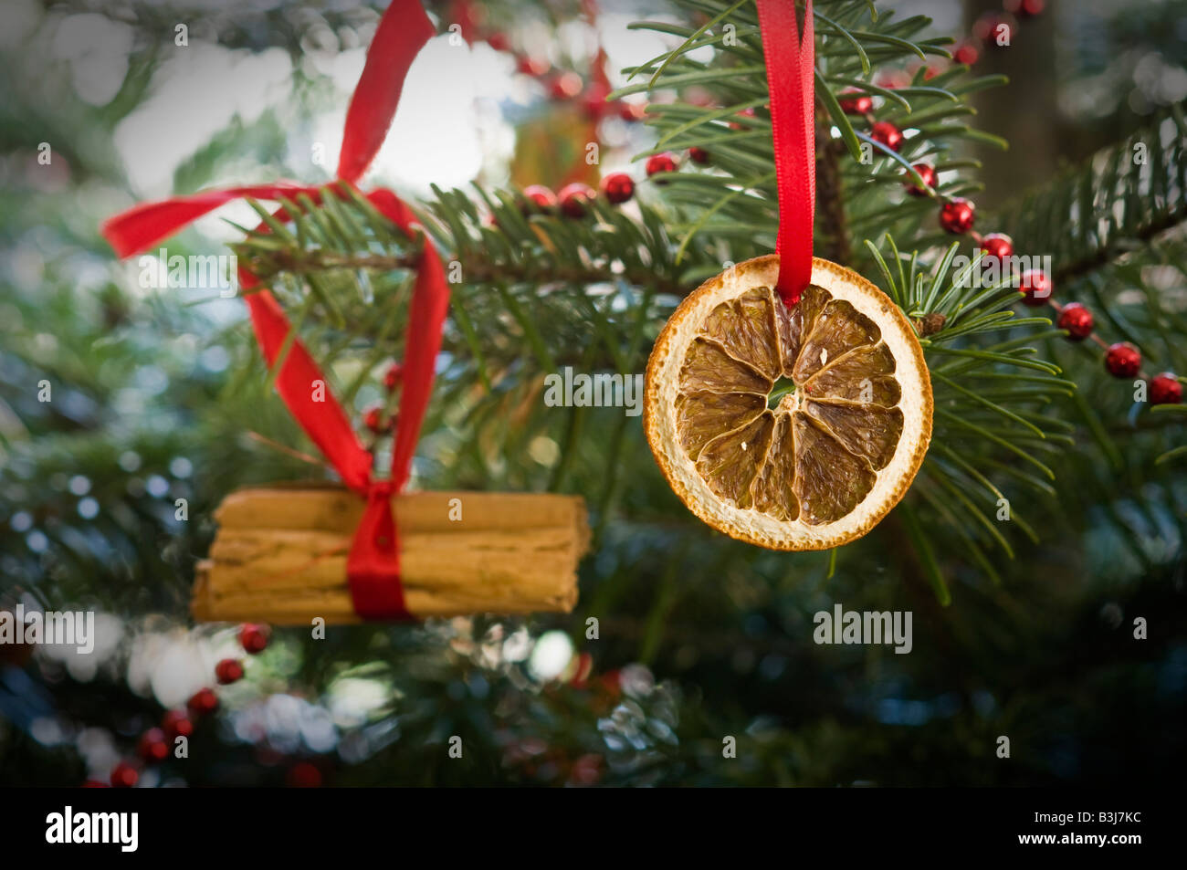 traditional christmas tree decoration comprising dried orange slices and cinnamon sticks