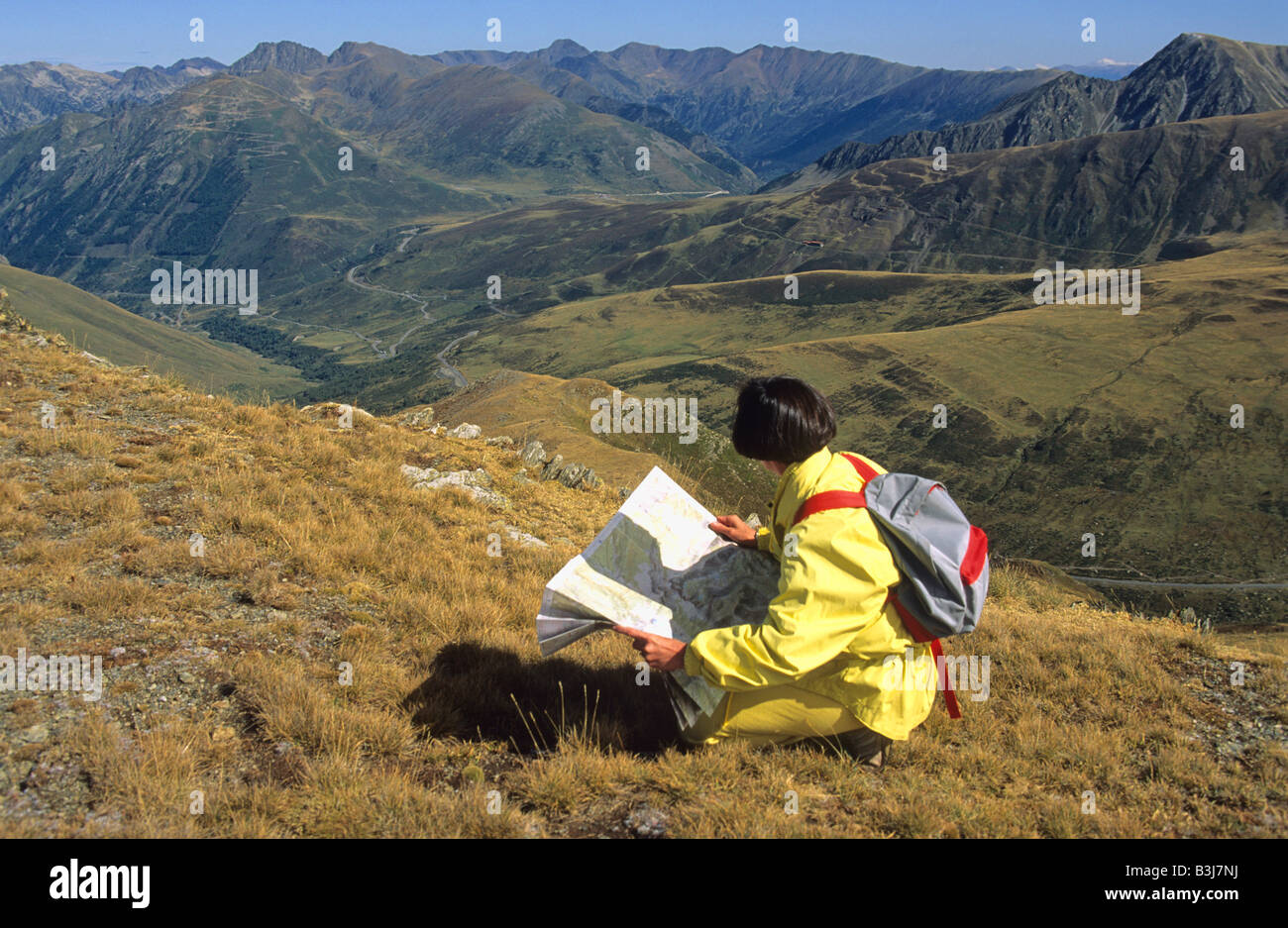 Woman Hiker Looking At A Map In The Pyrenees France Europe Stock