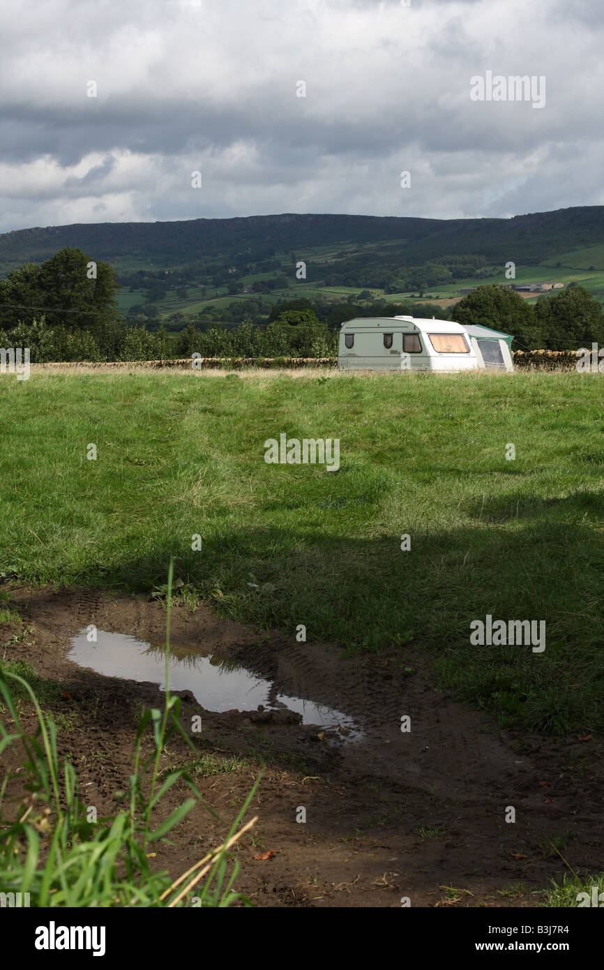 A touring caravan with awning on a camp site in the Peak District, Derbyshire, England, U.K. - Stock Image