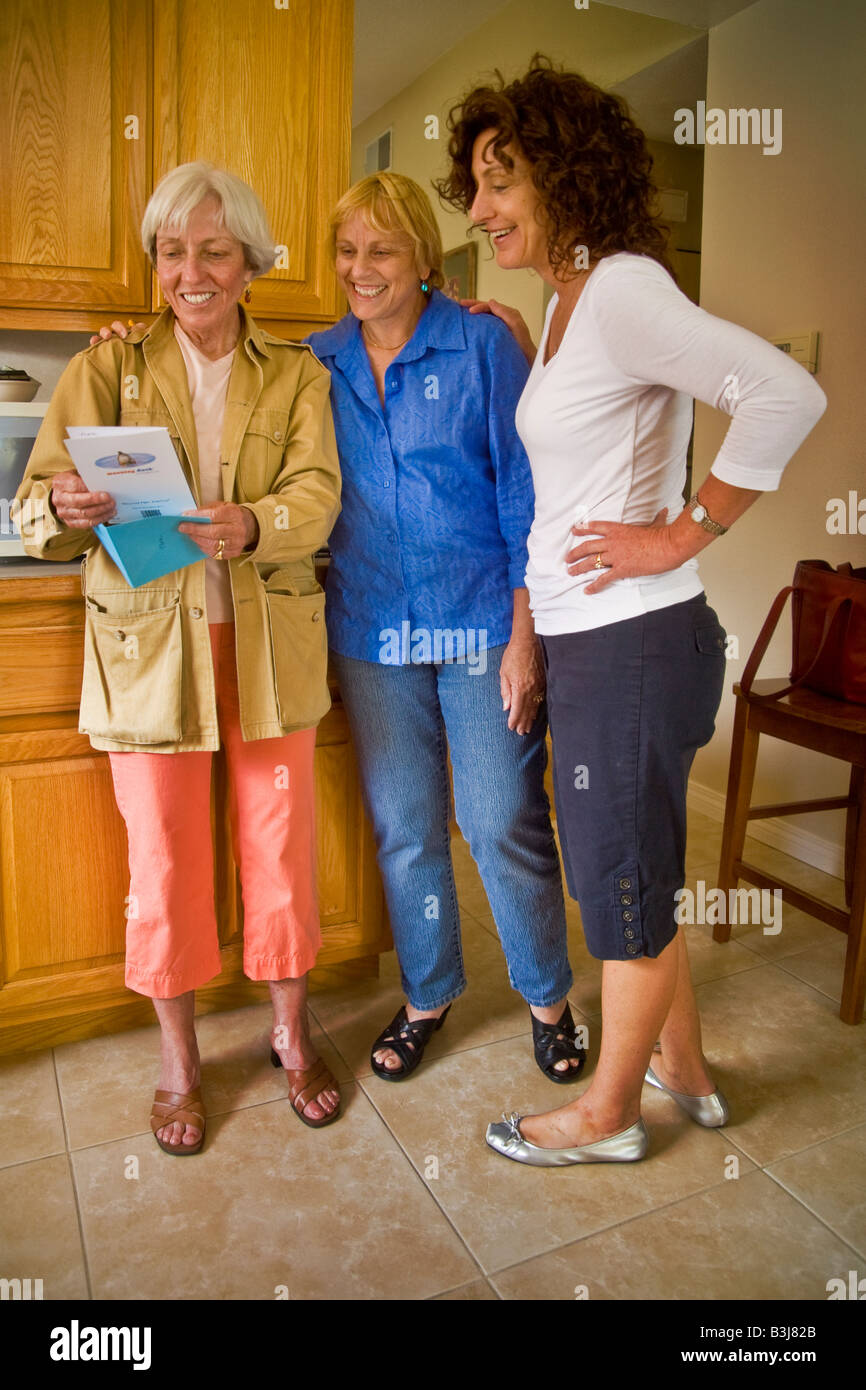 Middle Aged Well Wishers At A 50 Year Old Woman S Birthday Party Right Peruse Their Hostesses Cards
