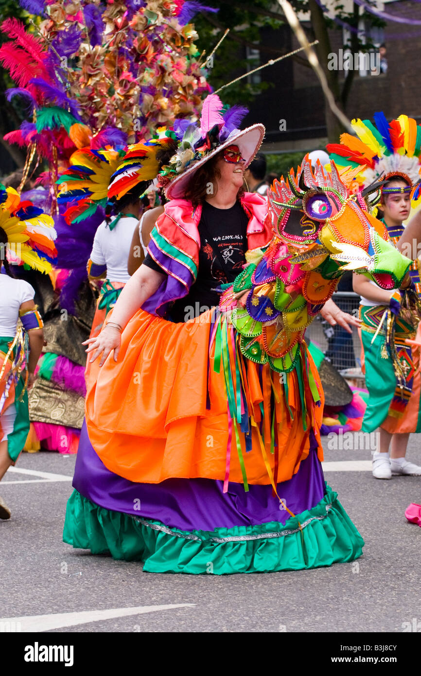 notting hill carnival parade , beautiful laughing mature white lady
