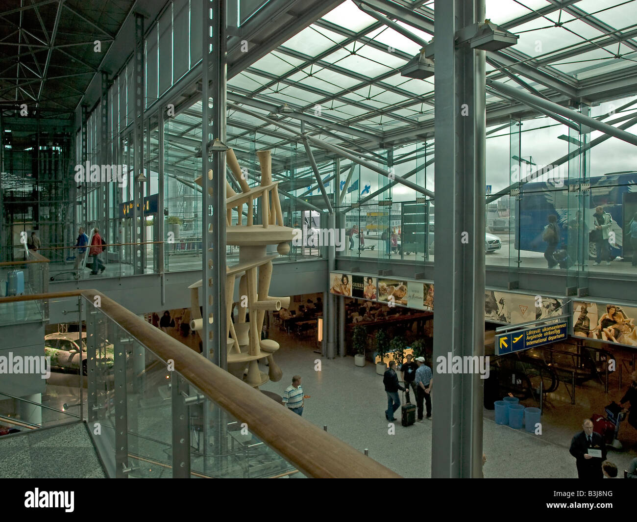 passangers in arrival area of the international terminal of the Helsinki Vantaa airport in Helsinki Finland - Stock Image