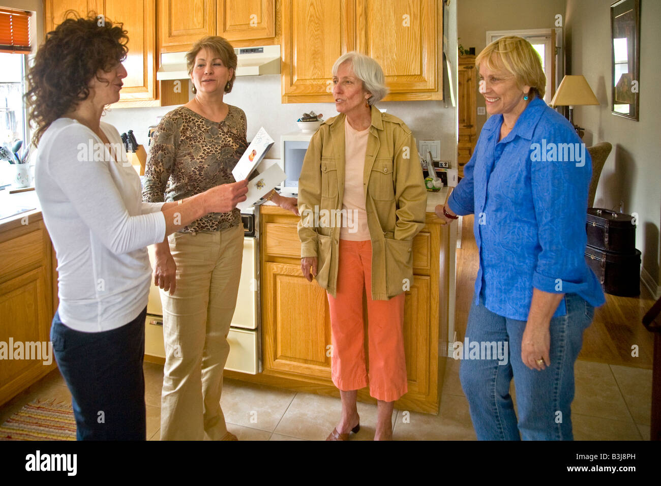 Middle Aged Well Wishers At A 50 Year Old Woman S Birthday Party Peruse Their Hostesses Cards