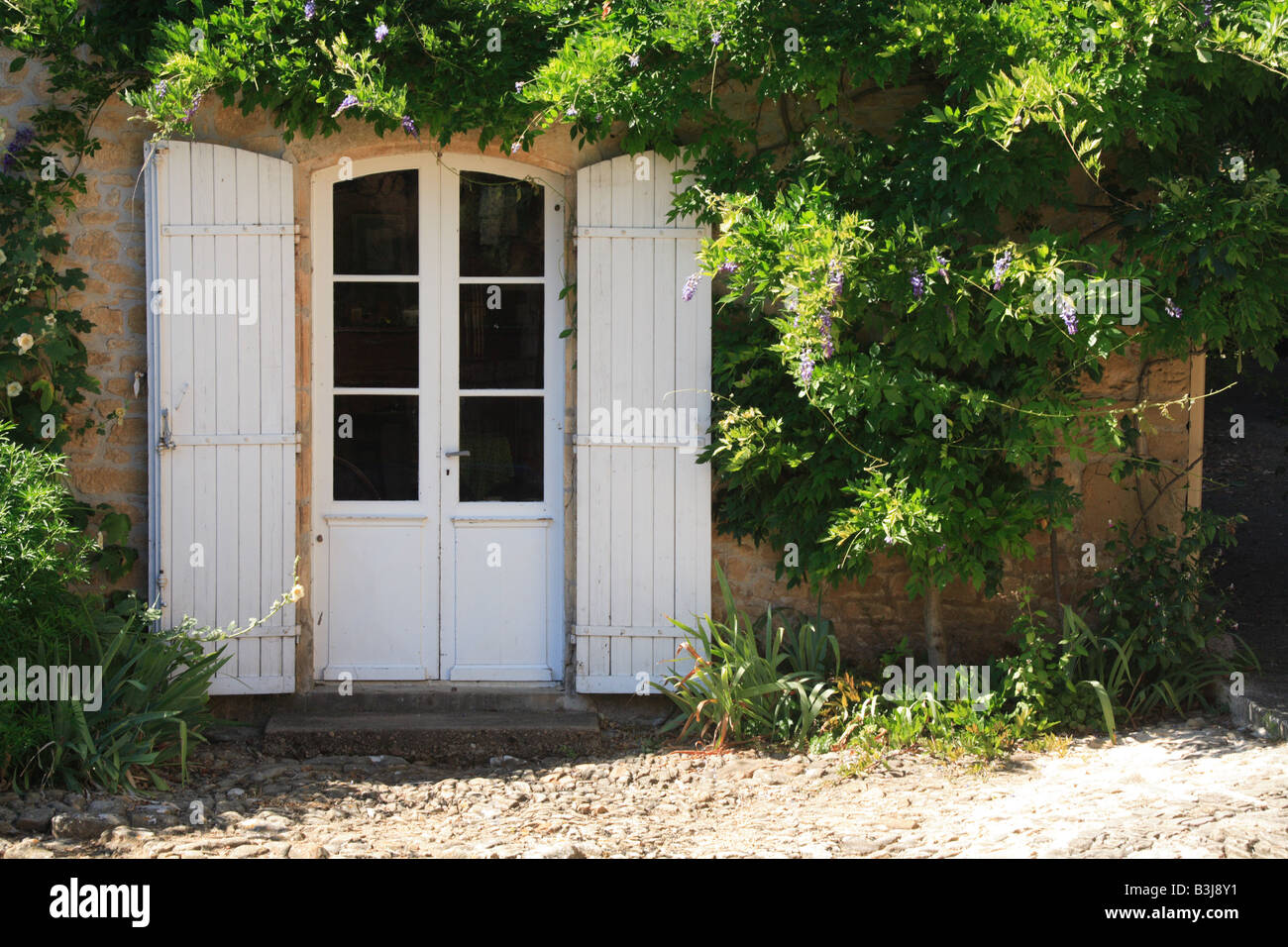 Limeuil village French doors Dordogne France & Limeuil village French doors Dordogne France Stock Photo: 19456501 ...