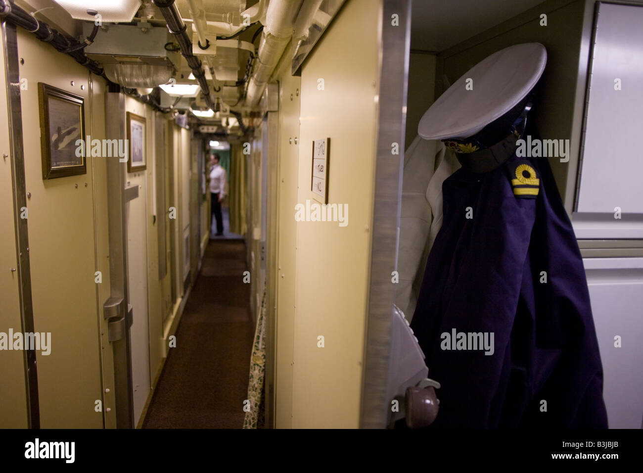 Naval Lieutenant's uniform belonging to a Weapons Engineering Officer aboard HMS Vigilant, a Vanguard class - Stock Image