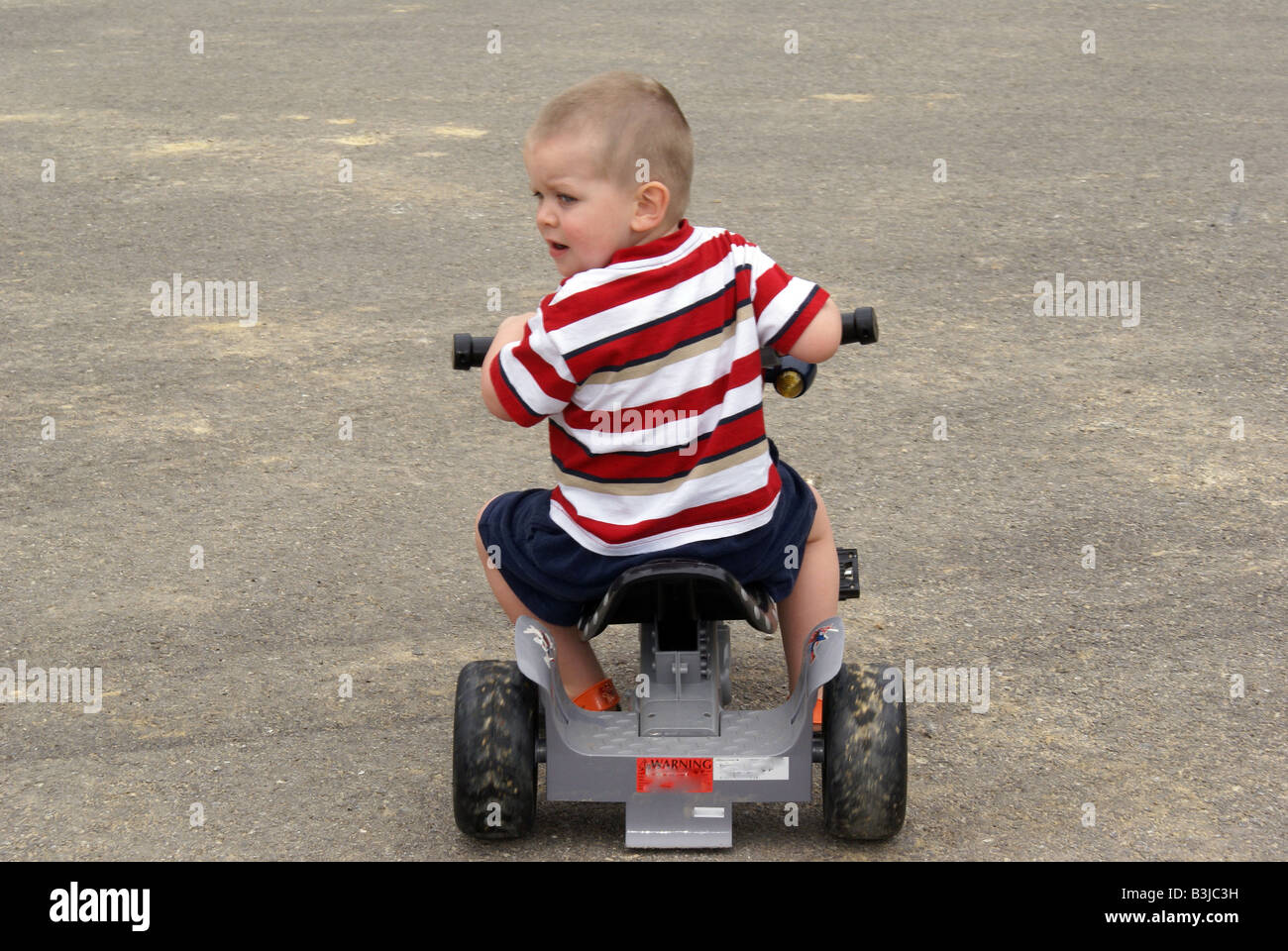 Riding Tricycle - Stock Image