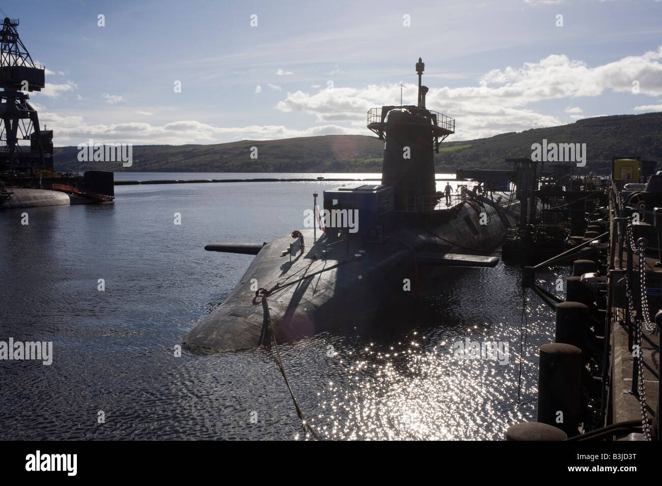 HMS Vigilant, a 15,000 ton British Vanguard class nuclear submarine docked at HM Naval Base Clyde, Faslane, Scotland - Stock Image