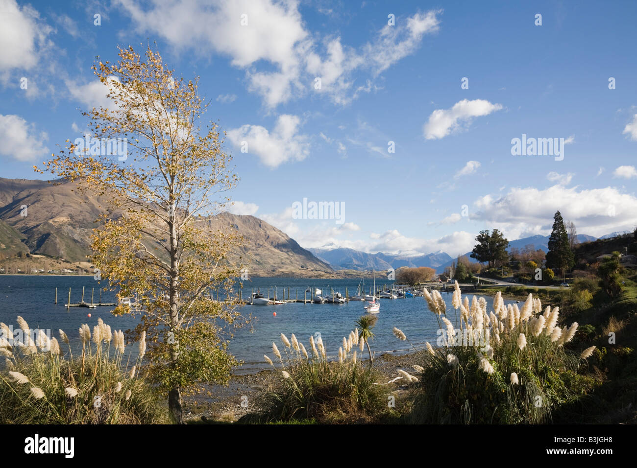 Wanaka Otago South Island New Zealand View across marina at southern end of Lake Wanaka to western shore from lakeside - Stock Image