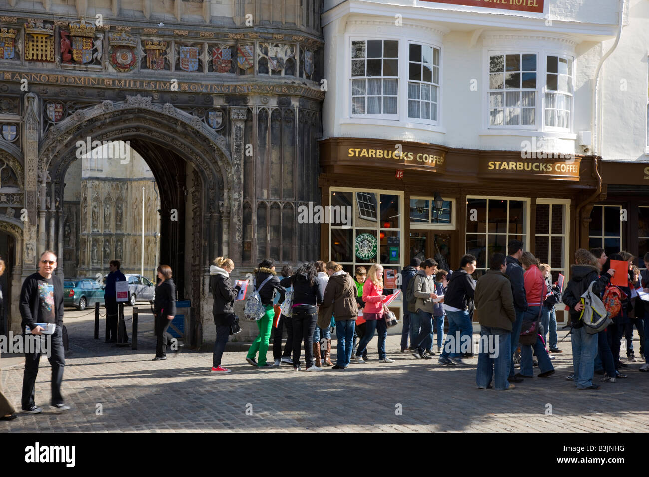 Great Tourists Congregating Outside The Gated Entrance To Canterbury Cathedral    Stock Image