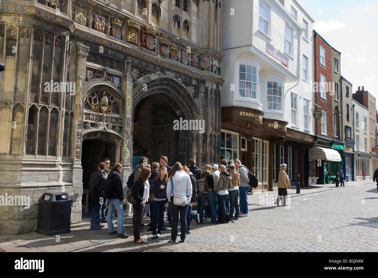 Tourists Congregating Outside The Gated Entrance To Canterbury Cathedral
