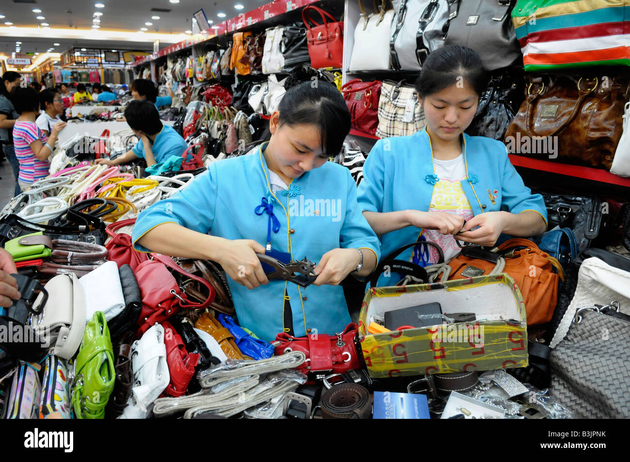 Sales ladies at the Hong Qiao Pearl Market in Beijing, China. - Stock Image