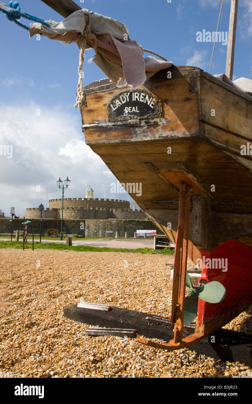 Boat on the beach with Deal Castle in the background - Stock Image
