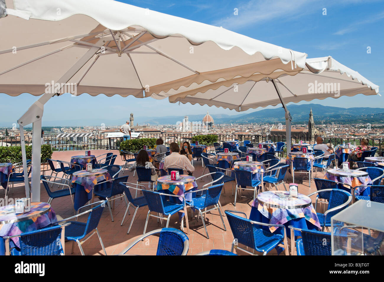 View over the city from a cafe below Piazzale Michelangelo, Florence, Tuscany, Italy - Stock Image