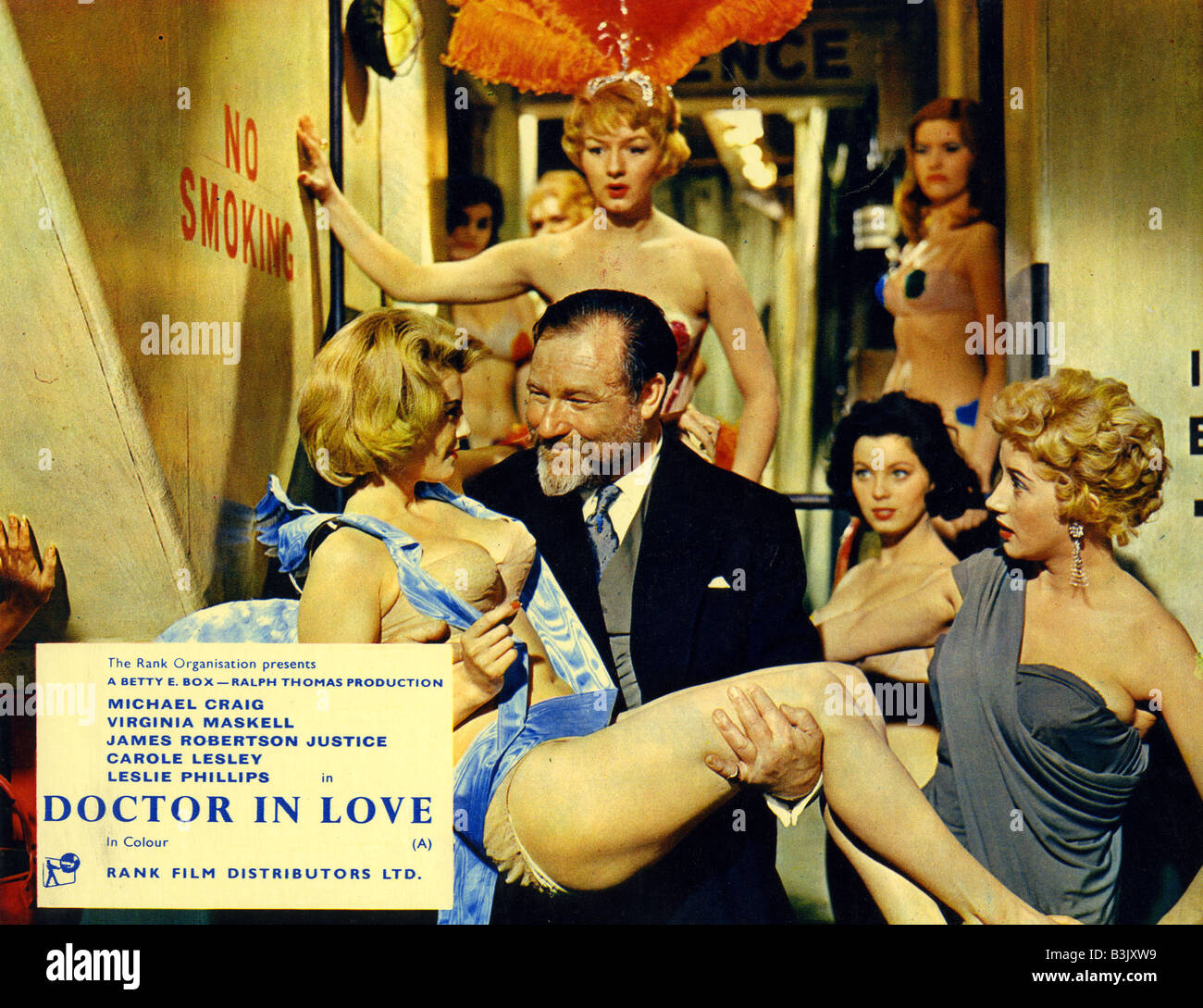 DOCTOR IN LOVE  1960 Rank film with James Robertson Justice and Joan Sims behind him - Stock Image