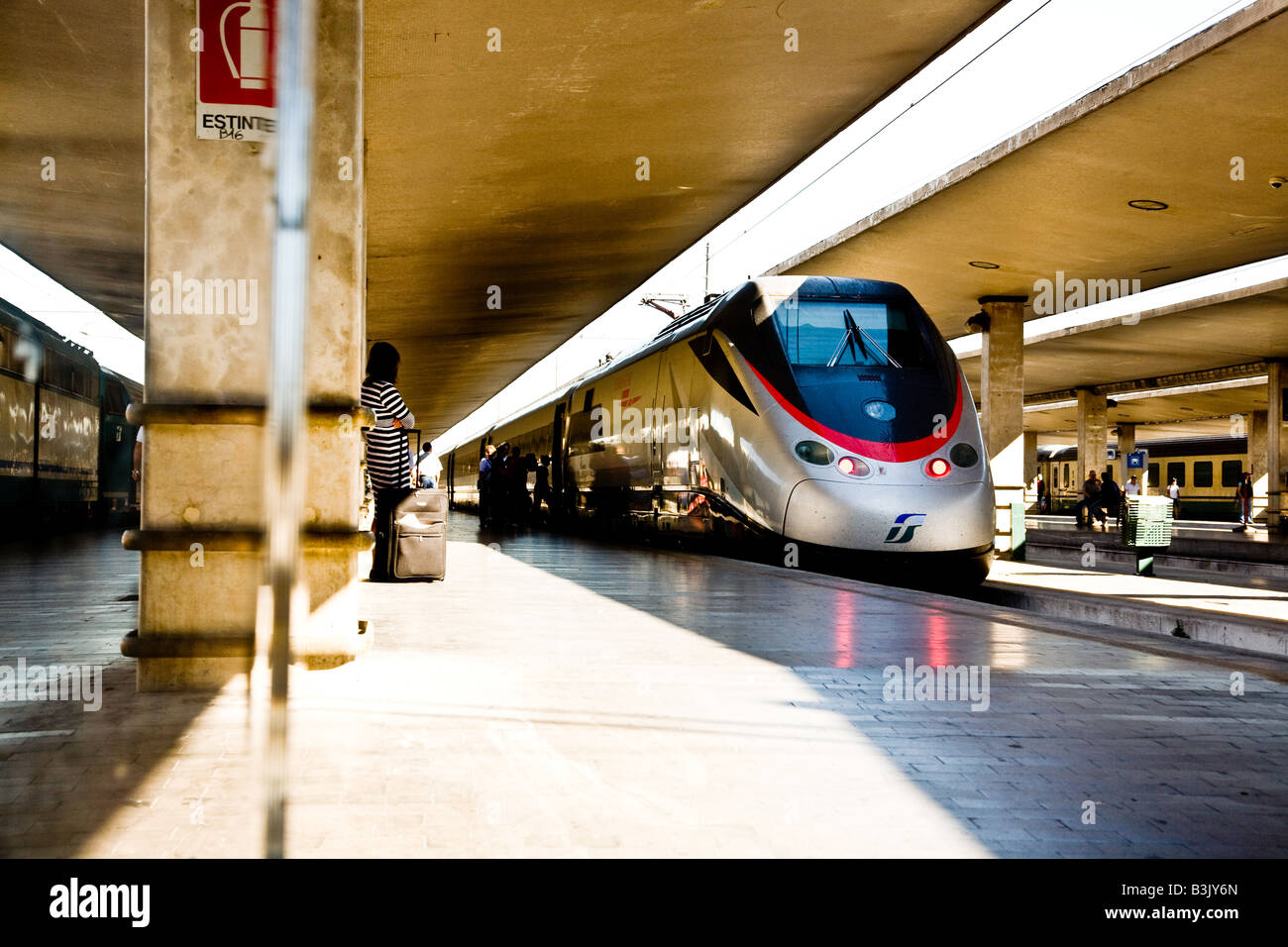 Eurostar Italia train about to leave Florence Station These High spped trains link up the major Cities of Italy Stock Photo
