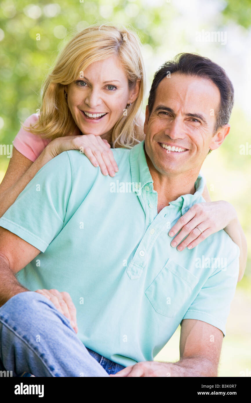 Couple outdoors smiling - Stock Image