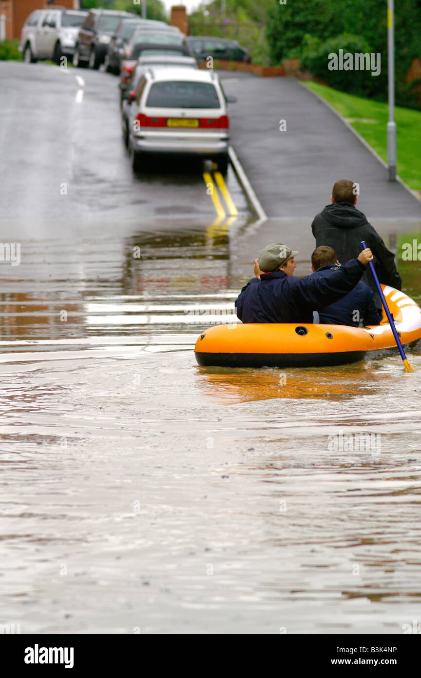 children escaped on the pontoon from flooded houses in Evesham during flood of the century. Evesham 2007. Worcestershie. - Stock Image