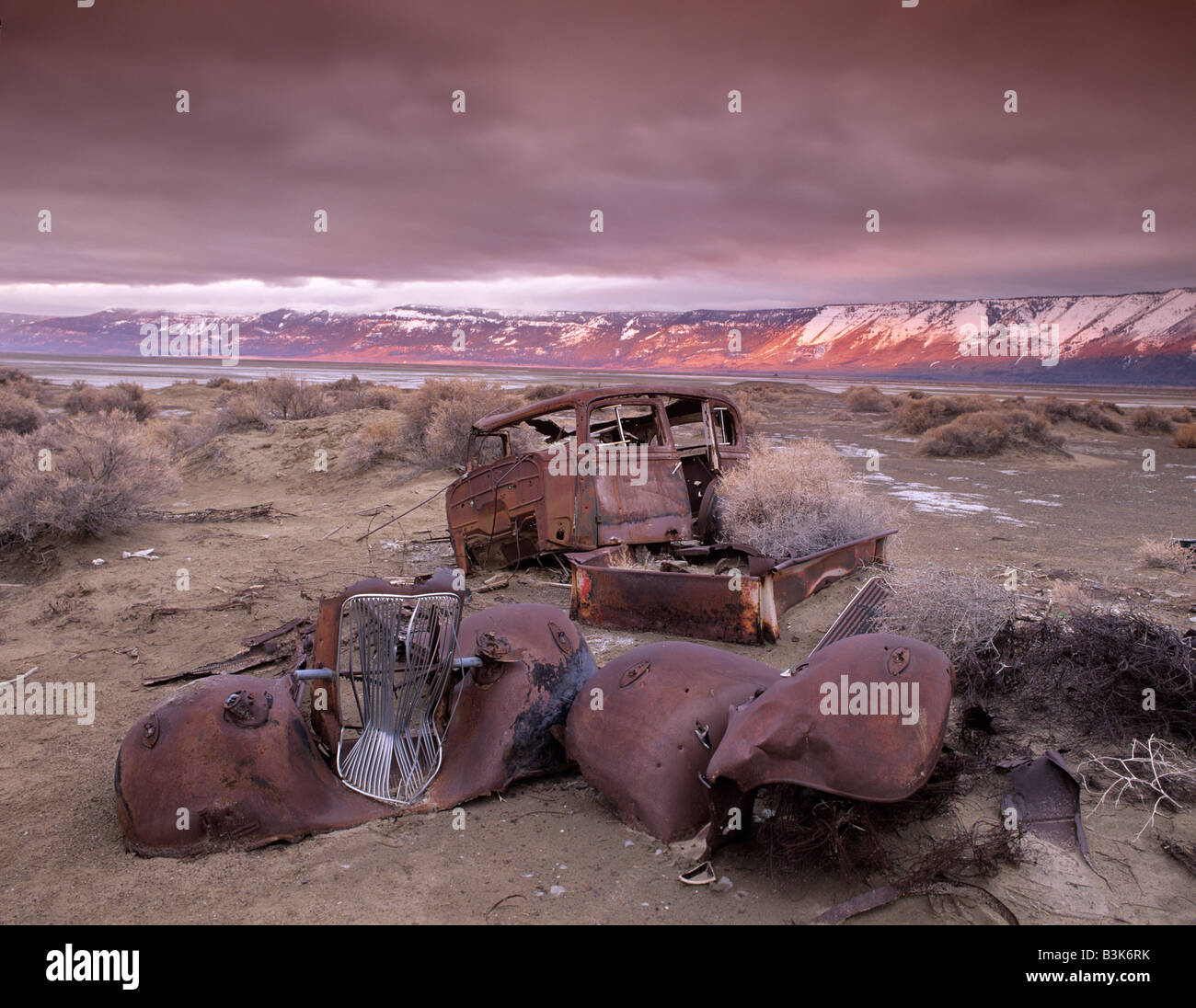 Abandoned car in historic dump Summer Lake National Wildlife Refuge Oregon - Stock Image