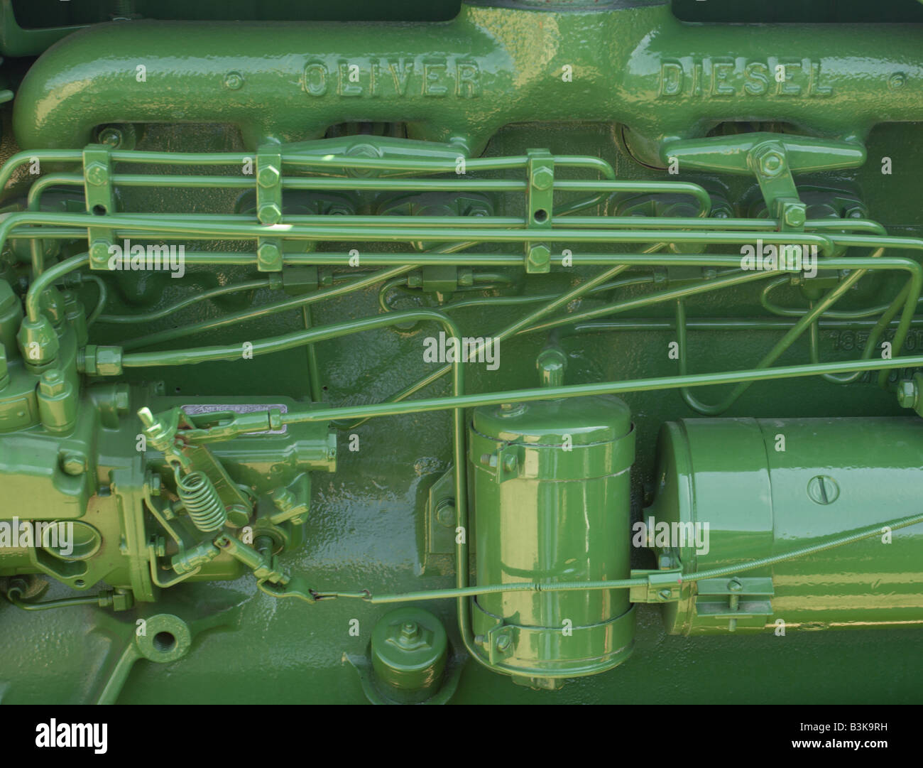 The manifold and exhaust of a 1955 Oliver Diesel tractor at a tractors show in Pennsylvania, USA. Stock Photo