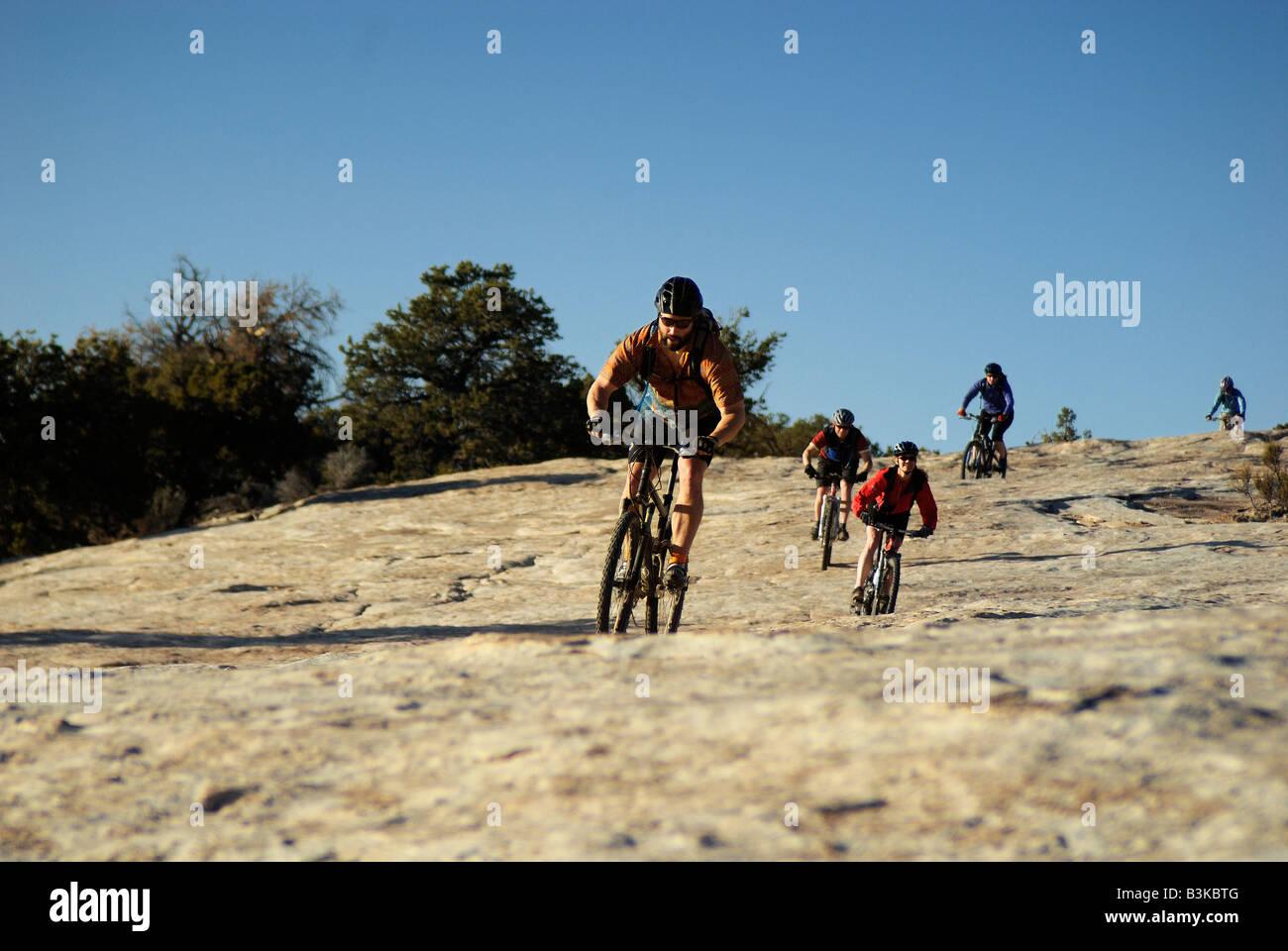 Slickrock Mountain Biking group Utah - Stock Image