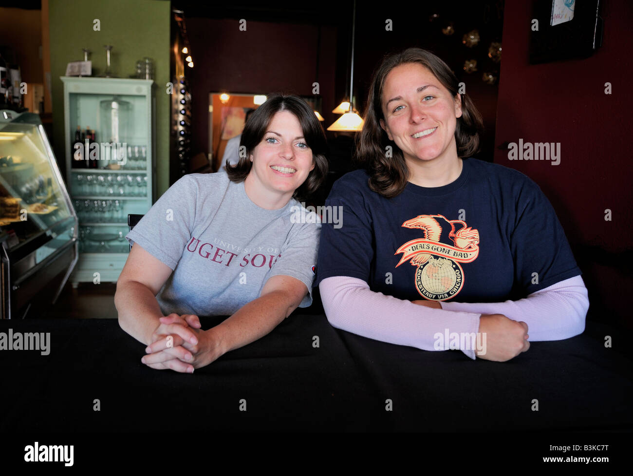 Two women sitting at a table in Upper Crust Bistro Bakery in Tacoma Washington United States North America - Stock Image