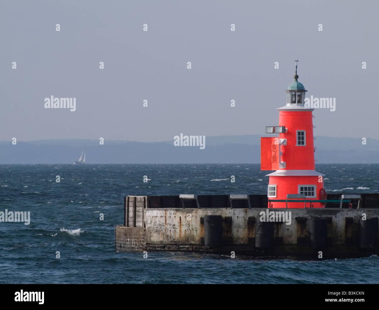 Beacon on the breakwater entrance to the Port of Helsingoer, Denmark - Stock Image