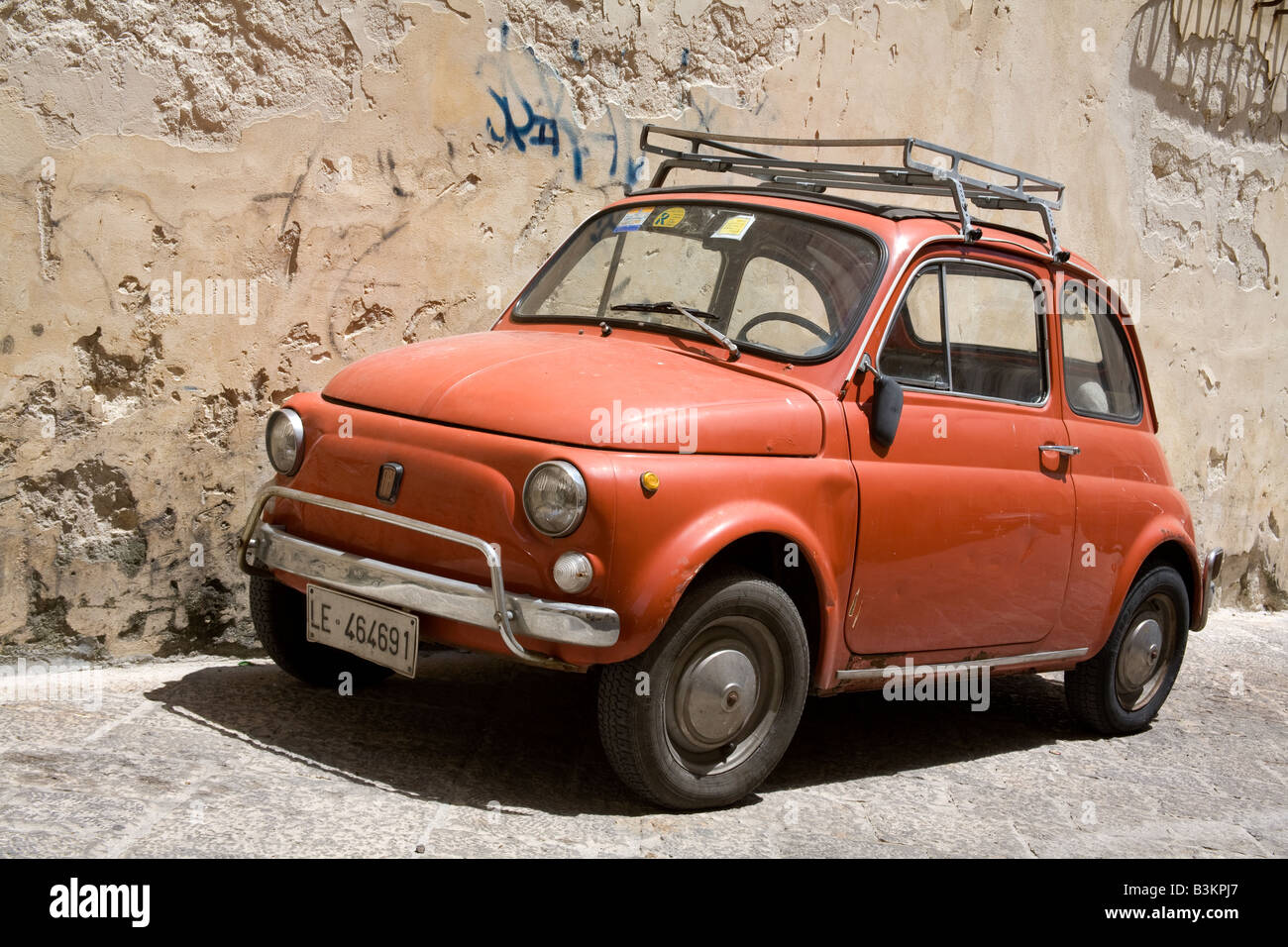 Old Red Fiat 500 Car With Roof Rack Parked In Lecce City Southern