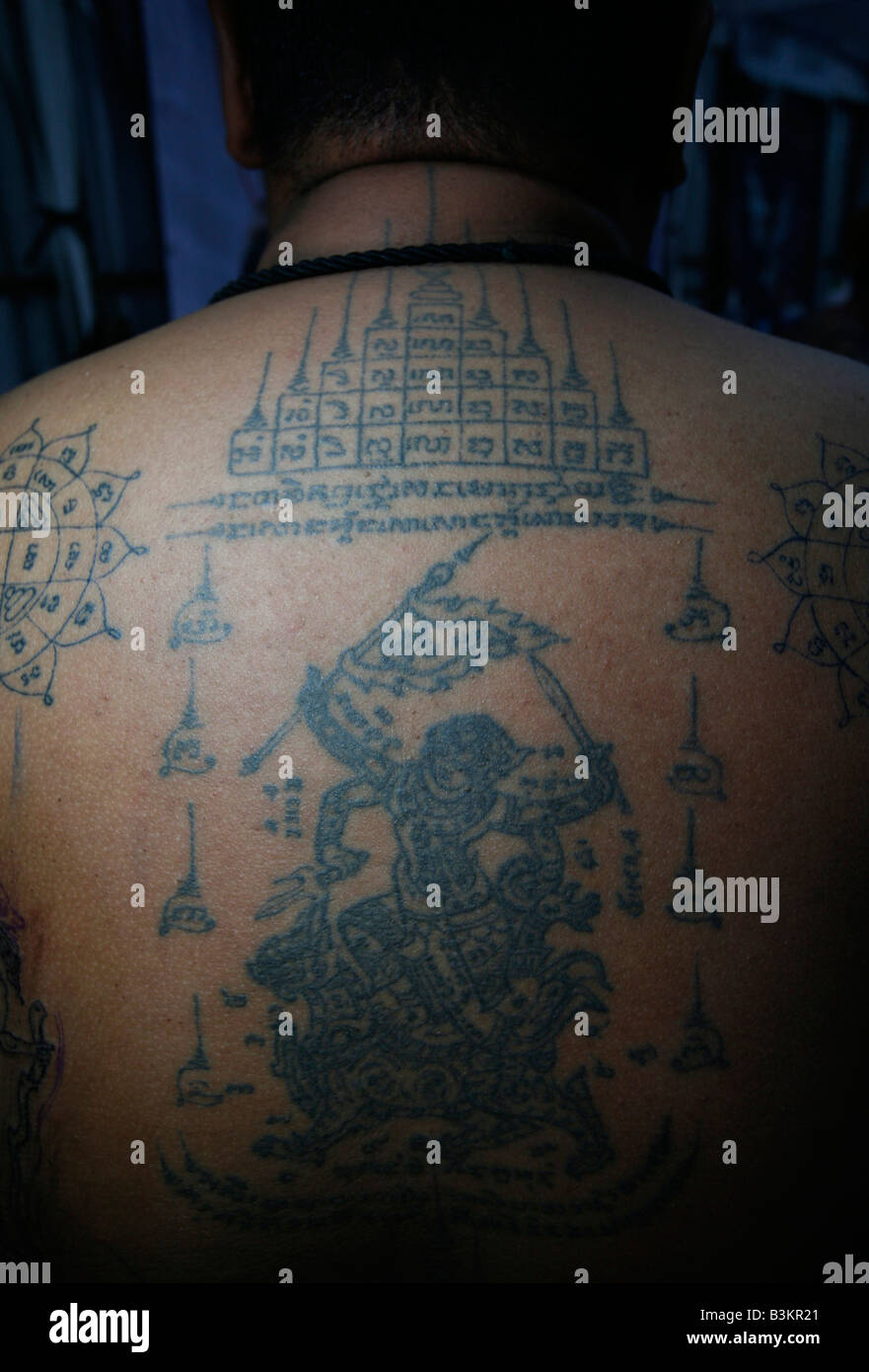 Religious Symbols Are Tattooed On A Mans Back At The International