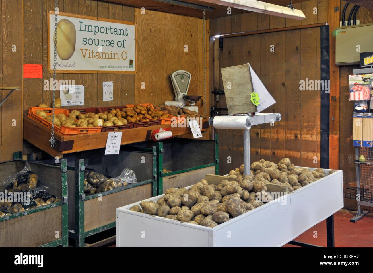Interior of retail farm shop locally grown potatoes on display - Stock Image