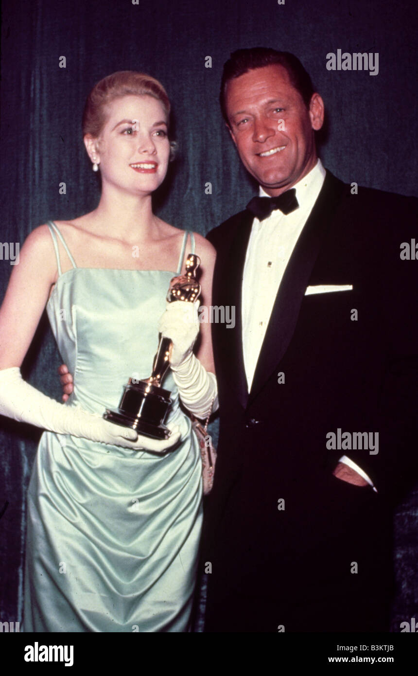 GRACE KELLY holds her Oscar for the 1954 film The Country Girl with co-star William Holden - Stock Image