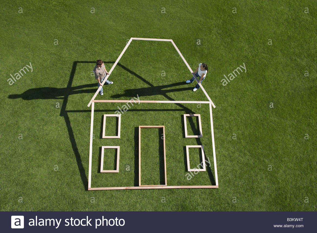 Couple building house outline - Stock Image