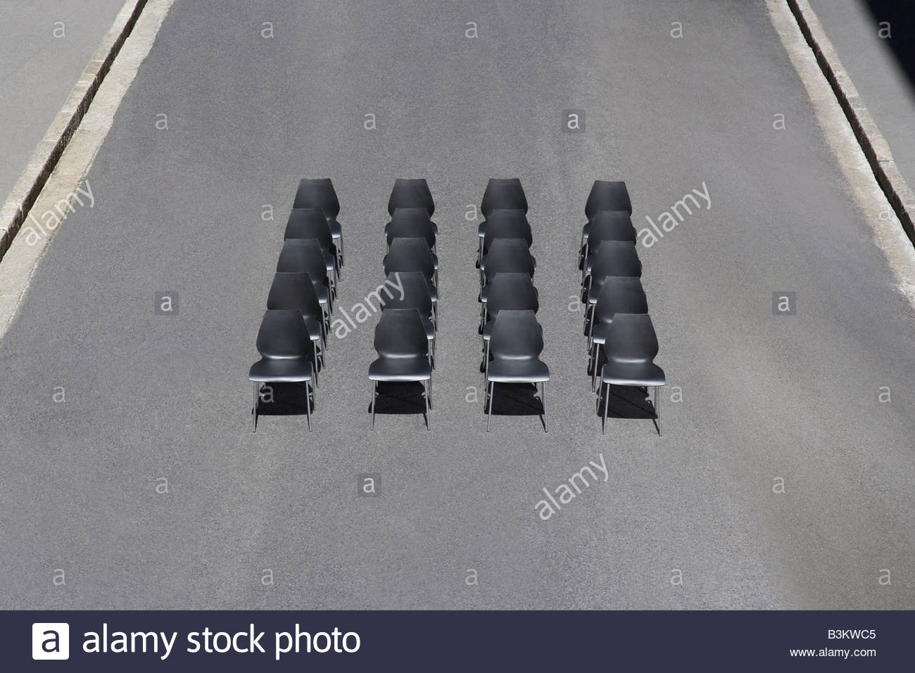 Empty office chairs in roadway - Stock Image