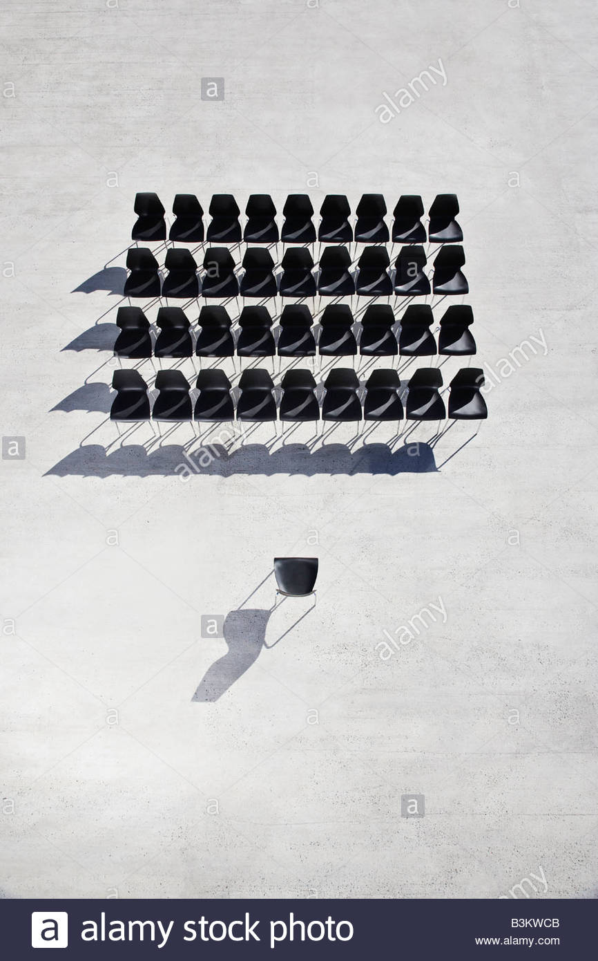 Empty office chairs on sidewalk - Stock Image