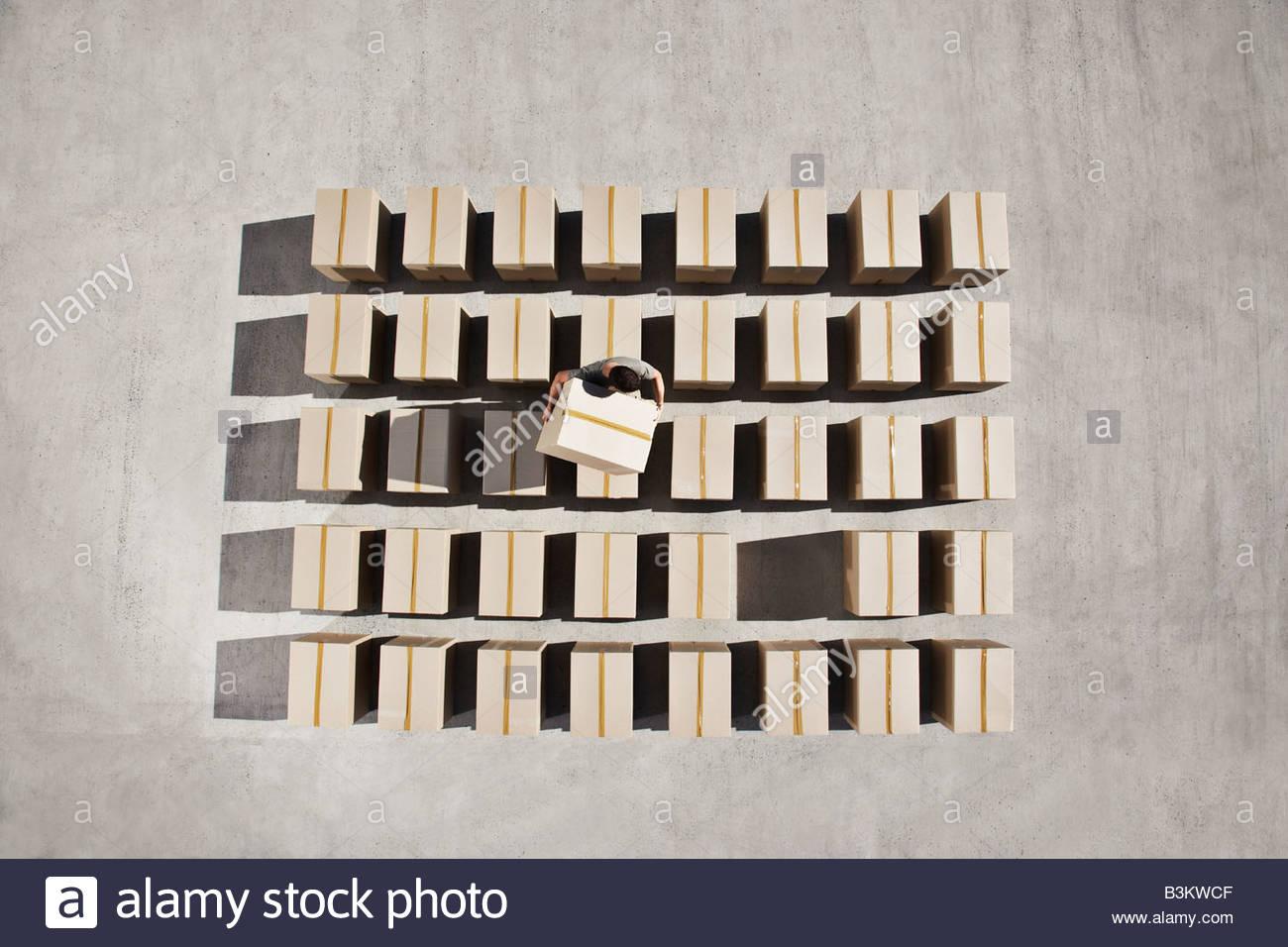 Man organizing boxes outdoors - Stock Image