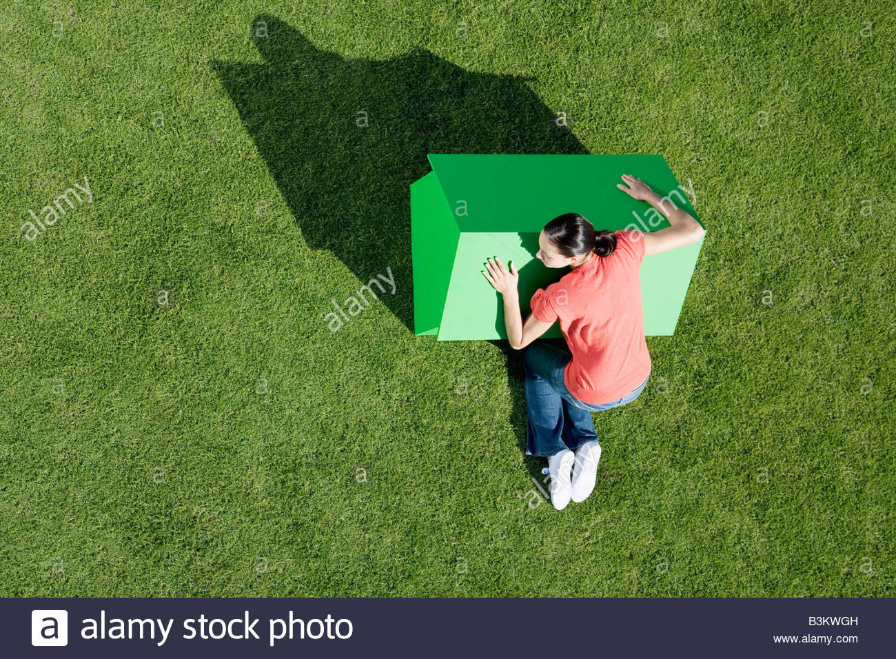 Woman hugging small model house Stock Photo