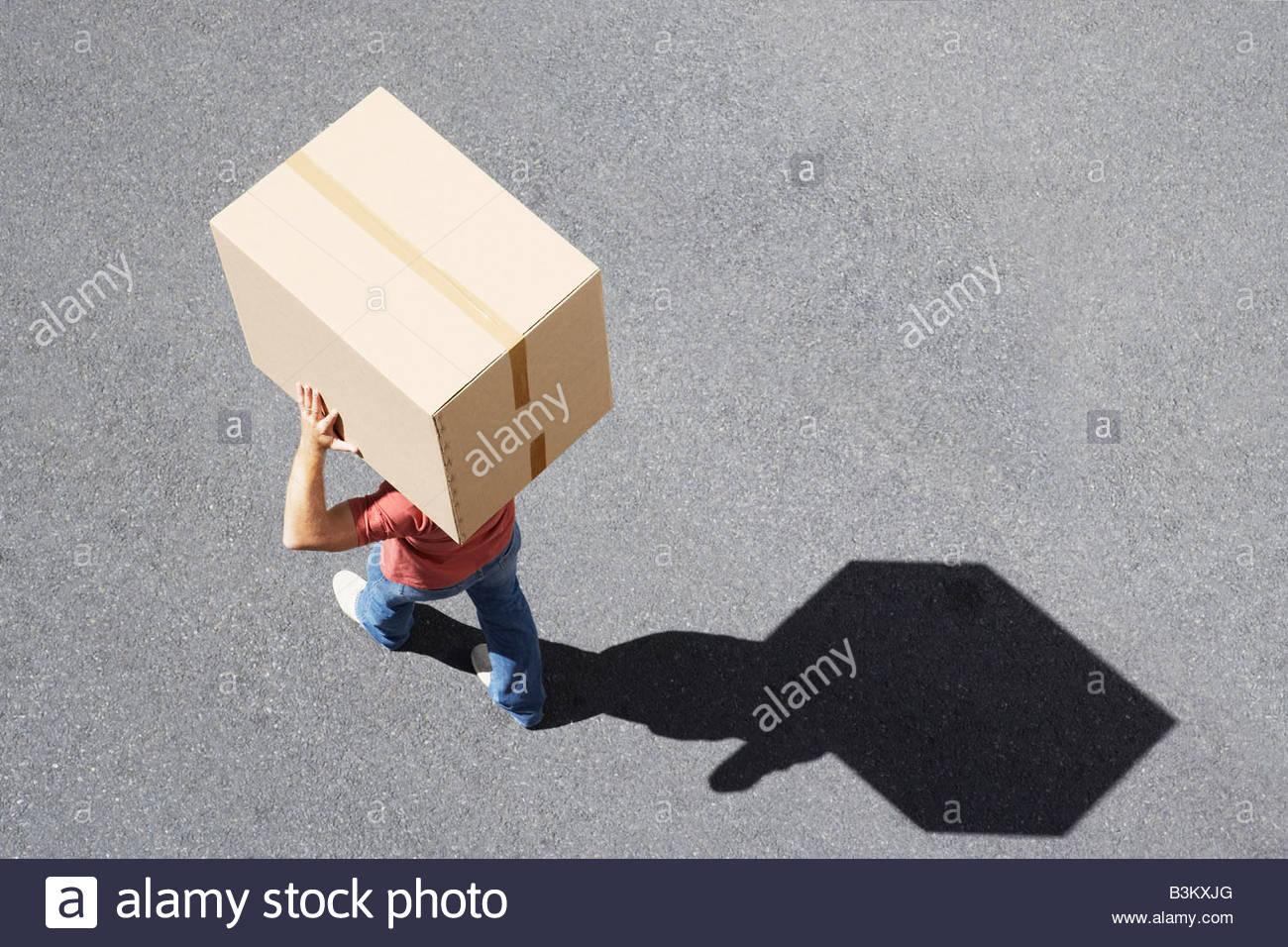 Man carrying box - Stock Image